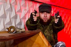 bearded terrorist with a gun - stock photo