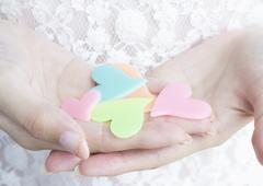 Hand holding hearts - stock photo