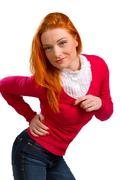 beautiful red-haired girl in a pink jacket isolated on a white - stock photo