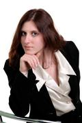Beautiful young woman posing in business suit Stock Photos