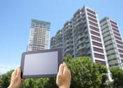 Stock Photo of High-rise condominiums and a tablet PC