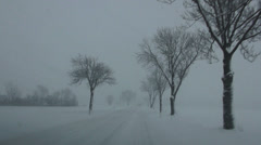 driving on snow covered road - stock footage