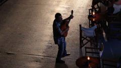 Entertainer singing and playing guitar Stock Footage