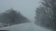 Driving car on snowy street in winter Stock Footage