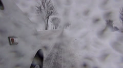 Driving car in heavy snowfall, getting worse Stock Footage