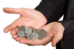 Hand in suit holding coins on white Stock Photos