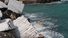 Waves splashing into marble blocks Stock Footage
