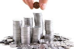 Silver coins are staying in the piles Stock Photos