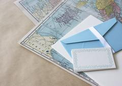 Letter stationery and maps Stock Photos