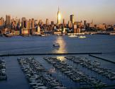 Usa, nyc, manhattan and boats at sunrise Stock Photos