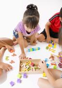 Children playing with a mental training toy Stock Photos