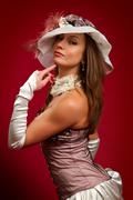 young brunette girl in a white hat - stock photo