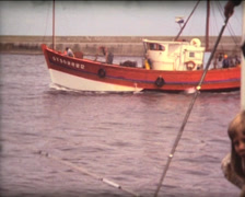 SUPER8 FRANCE Britanny fishing boat back to harbor - 1978 Stock Footage