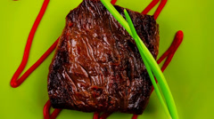 Meat food : roast beef fillet mignon served on green Stock Footage