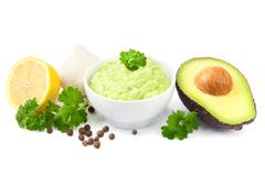 Guacamole and ingredients Stock Photos