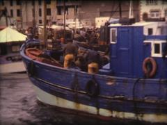 SUPER8 FRANCE Britanny fishing boat back to harbor with fresh fish 4 - 1978 Stock Footage