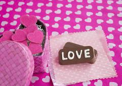 "Chocolates with ""LOVE"" and a gift box Stock Photos"
