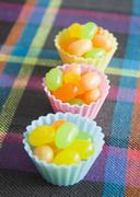 Jellybeans in silicone cups - stock photo