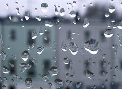 Raindrops on glass window Stock Photos