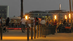 Evening Walkers by the Beach Front 1 Stock Footage