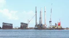 Oil rigs in ocean water Stock Footage