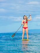 stand up paddle surfing in hawaii - stock photo