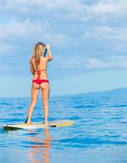Stock Photo of stand up paddle surfing in hawaii