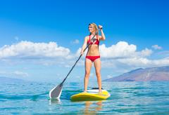 Stand up paddle surfing in hawaii Stock Photos