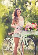 beautiful young woman on bike - stock photo