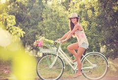 beautiful young woman on bike - stock photo