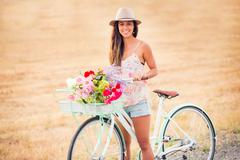 Beautiful young woman on bike Stock Photos