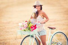 Beautiful young woman on bike Stock Photos