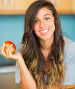 Beautiful young woman holding red apple Stock Photos