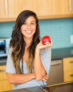 beautiful young woman holding red apple - stock photo