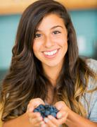 woman with fresh blueberries - stock photo