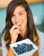woman with bowl of blueberries - stock photo