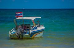speedboat and thai flag - stock photo