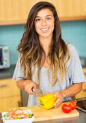 woman chopping vegitables, preparing healthy dinner - stock photo