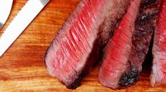 Big rare roast steak on wood Stock Footage