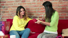 Woman giving birthday gift to her best friend in home HD Stock Footage