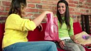 Stock Video Footage of Woman giving birthday gift to her best friend in home HD