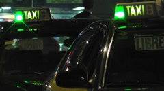 Night taxi departs with people, with green meter light Stock Footage