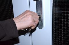 Hand unlocks doors Stock Photos