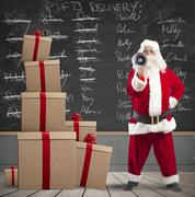 santa claus and list of gifts delivery - stock photo