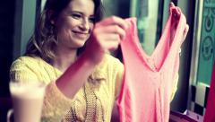 Beautiful woman checking her new clothes in cafe HD Stock Footage