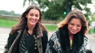 Stock Video Footage of Happy girlfriends walking through street on zebra crossing HD