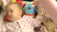 a baby sleeping in a cradle - stock footage