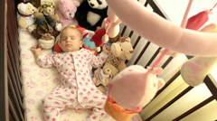 A baby sleeping in a cradle Stock Footage