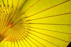 Under the umbrella of the yellow. Stock Photos