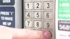 Entering pin code at keypad Stock Footage